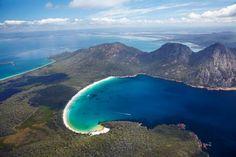 Wineglass Bay, and The Hazards, Freycinet National Park, Freycinet Peninsula, Eastern Tasmania, Australia - aerial