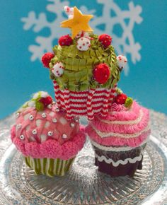 Knitted and embelished cupcake ornaments.