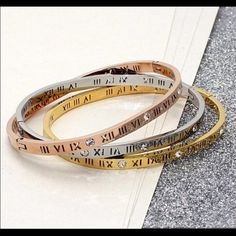 BRAND NEW Roman Numeral Rhinestone Bracelet $20 Selling #brandnew  Roman Numeral Rhinestone Bracelet. High quality STAINLESS STEEL,  and great for arm candy stacks. Available in 18K Gold Plated and 18K Rose Gold Plated & Silver $20 each or 2 for $35! Only a few pieces left. Great Holiday Gift  or #stockingstuffers! Not branded. PLEASE COMMENT BELOW IF INTERESTED TO BUY,  I will make you a new listing to purchase from ❤️ Michael Kors Jewelry Bracelets