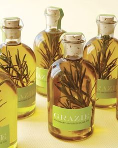 """Wedding Favors: Rosemary Olive Oil To create this Italian specialty, place a few snips of herbs in an empty bottle, pour in olive oil, cork, and seal with clip art. Materials: Specialty Bottle """"Boston"""" glass bottle with cork. Destination Wedding Favors, Edible Wedding Favors, Party Favors, Shower Favors, Wedding Programs, Diy Party, Party Gifts, Shower Invitations, Diy Gifts"""