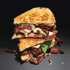 Grilled Cheese and Short Rib Sandwiches with Pickled Caramelized Onions and Arugula. I'm going to try making it with chuck roast to save on cost.