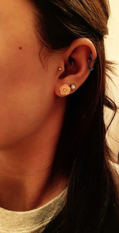 Double helix, daith, and tragus piercings #piercings