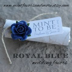 elegant wedding favors with ivory wrap and royal blue roses
