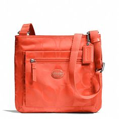 NWT Coach Getaway Signature Nylon File Bag Hot Orange. Starting at $18 on Tophatter.com!