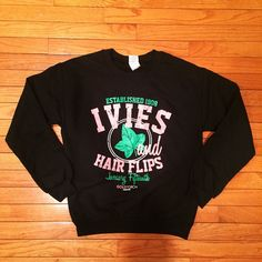 """""""Black is the new black.  The 'Ivies and Hair Flips' Crewneck in black. Now available at www.goldtorchapparel.com"""" Aka Sorority, Alpha Kappa Alpha Sorority, Sorority Shirts, Miss Priss, Sigma Gamma Rho, Hair Flip, Alpha Female, Pink And Green, Graphic Sweatshirt"""