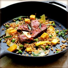 Warm steak and farro salad with roasted beets, onions, and chickpeas.