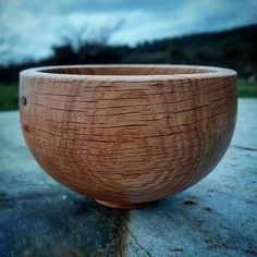 A small Oak bowl, dry, oiled and ready for it's new home.  I make these bowls from off cuts from my green oak timber frame jobs. The wood is usually lying around for a couple of years before I turn it so is part dry when turned, then I store the turned bowl in a brown paper bag for a week or so to let it finish drying slowly before it is given a coat of cold pressed linseed oil mixed 5.1 with Cornish  beeswax. • • • • • • • • #woodenbowl #woodturning #latheturned #oak
