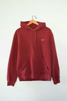 c98fa969a9f83f A white embroidered swoosh on a comfy maroon cotton hoodie. Brand is Nike.  Size is Men s Medium.