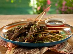 Skewered Lamb with Spicy Pomegranate-Rioja Red Wine Vinaigrette and Mint-Almond Relish recipe from Bobby Flay via Food Network
