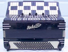 Google Image Result for http://www.well.com/~jax/images/misc_free_reed/reuther_accordion.jpg