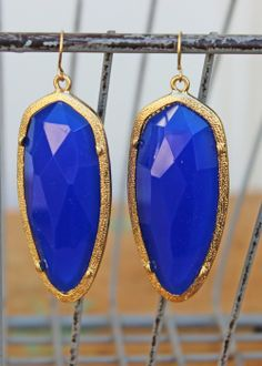 """Teardrop resin beads rimmed in gold add appeal and a pop of color to any outfit...dive in. Measure 2 1/2"""" including hook.  $25.00"""