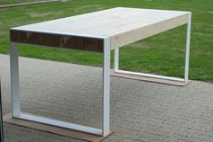 Handmade dining table. Pure contemporary design. Steel and
