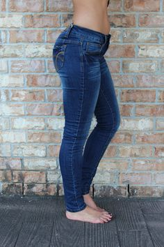 """Dark denim skinny blue jeans with five pocket - Body length:37.5"""",insim-29.5 - 76% Cotton, 22% Polyester, 2% Spandex - Junior sizing order up if you typically wear women's sizes Alexis is a size 0, he"""
