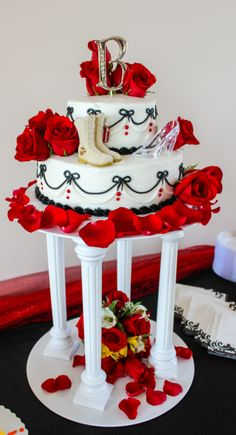 A Wedding Cake following the theme The Marine gets his Princess. The cake has combat boots and a glass slipper on it.