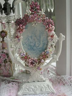 "The artist calls this her ""Little Miss Muffet Frame"" covered in pink jewels"