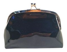 A personal favorite from my Etsy shop https://www.etsy.com/listing/259928538/black-faux-paten-leather-clutch-handbag