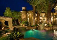 This Vegas home has a resort feel with its backyard water park and beach island, swim-up bar and lazy river.