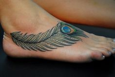 I'd like this type of design across my shoulder blades, like they're wings, but maybe in the Albino peacock colours with light blue and gold for accents on the feather detail
