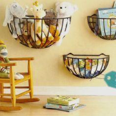Use garden hanging baskets mounted low in a kid's room to corral toys and books.  Be sure to secure to your wall studs !