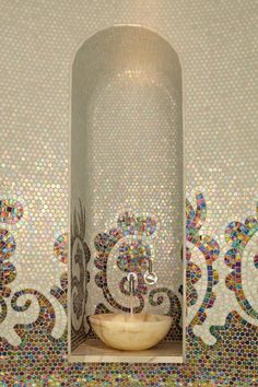 Beautiful mosaic tile powder room. Gorgeous alcove, could be used in a foyer or as a focal point for a room.