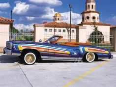 Remembering the documentary Sunday Driver (the art of lowriding), I started looking for images of The Santana. I found it + this on Lowrider Magazine's site. I recommend the film. It's awesome to see the elaborate process required to create these works of art.