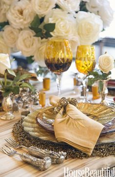 Layer your way to an elegant look, inserting metallic accents to pick up glimmering candlelight. The colored glasses cast off another lovely glow. Click through for more stunning table decorations for any occasion.