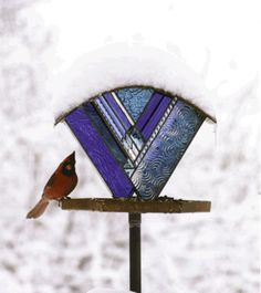 BEAUTIFUL stained glass and copper bird feeders