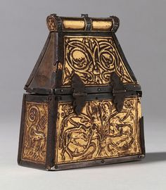 Culture: English or French?      Date: late 8th century; ridge pole late 9th  century      Material: Gilded copper alloy (repoussé) on wood core      Dimensions: 15.6 × 13 × 6 cm      Inscribed: ΚΑ-Ρ; ΒΑ-Ρ; Κ-Σ Θ-Σ; Ι-Σ Χ-Σ; Σ-Ο Τ-Ρ (see object description)  Provenance: Probably Moissac Abbey, France, possibly before 1669 (inventory reference); private ownership from 1801; Private Collection, London, 2008