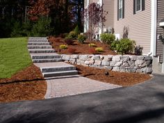 natural steep slope landscaping ideas Granite steps paver walkway granite wall and garden all combine to