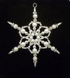 Snowflake Ornament - White Pearl Silver and Clear AB - Christmas Ornaments - Beaded Ornaments - Holiday Decorations.  via Etsy.