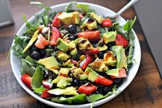 Spinach, arugula, blueberries, strawberries, avocado, pistachios, olive oil and balsamic.