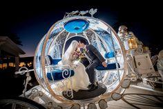 Gorgeous nighttime shot of happy newlyweds in Cinderella's Coach. Photo: Ali, Disney Fine Art Photography