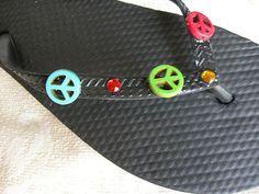 Adorable pair of colored peace sign flip flops on Ebay.com at seller LolaRachel954