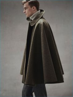 Explore New Silhouettes: Thorben Gartner wears cape coat Cini, turtleneck…