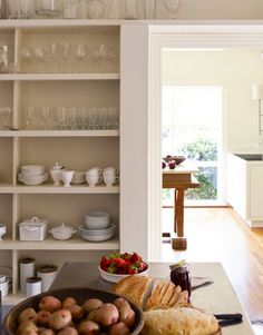 Perfect built in for displaying dishes in a dining room - why hide pretty dishes?