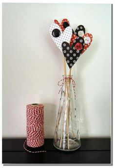 vase and paper hearts with buttons, vday decor