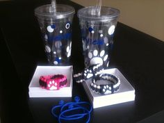 This bundle was created for an elementary school and included custom cups and paracord bracelets with matching paw prints! Fill the cups with beverages and sell with your concessions for a unique and cute fundraising idea! www.jemhedz.com