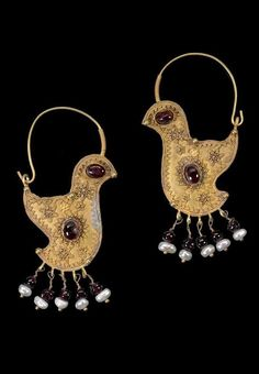 Greater Syria or Persia   Pair of gold hoop 'bird' earrings; gold, with garnet…