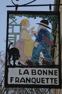 """18th arrondissement - hanging sign """"La Bonne Franquette"""" 2 Rue des Saules, Montmartre."""
