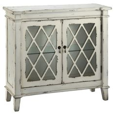 Featuring 2 glass doors and an antiqued white finish, this hand-painted cabinet makes a stylish complement to neutral decor.   Product: ...