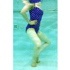 """FROG JUMP:   Starting from a """"plie position"""" (heels together, knees bent outward, and bottom tucked under), jump as high as you can out of the water, returning to the plie as you land. The deeper you go in the water, the harder your quads and butt will have to work to propel you out of it.  Tip: To really work those inner thighs, go as quickly as you can with no rest at the top or bottom of the move."""