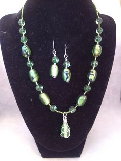 Special order.  Emerald green cats eye beads. Matching earrings.