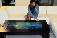 The coffee table as PC. A company called Mozayo sells a coffee table, basically a high-end Microsoft Windows PC with a 42-inch high-definition display as the table surface. It also has a touch interface layer, which enables you to use it without a keyboard or mouse.  The Mozayo sits in a wood-grain, dark-stained coffee table. In addition to the touch interface, it comes with a few custom applications.