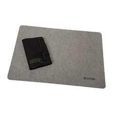SPOT is a protective mat for your desk made from natural woolen felt (100% wool).