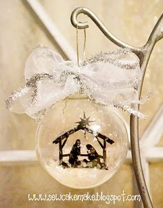 Cute. I love that the nativity silhouette is hanging inside the glass. So…