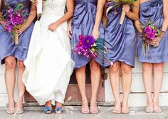 Wedding bouquets -peacock feathers and flowers in purple lisianthus, orchids and purple dahlias