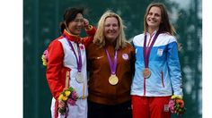 Medalists from women's Skeet Shooting  Silver medalist Ning Wei of China, gold medalist Kimberly Rhode of the United States and bronze medalist Danka Bartekova of Slovakia pose on the podium during the medal ceremony for the Women's Skeet Shooting.
