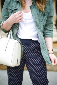 Mae Amor- printed joggers, Kate Spade bag, white crop tank, green military jacket