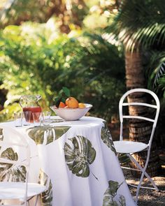 Leafy Tablecloth  A round cotton tablecloth printed with dramatic leaves makes a statement at any outdoor party.  Tablecloth How-To