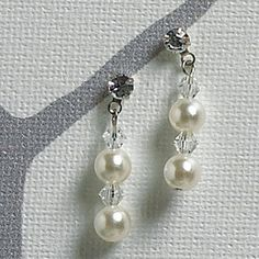 """Masterfully thread onto an invisible filament, pearls and crystals seem suspended in mid air. This illusion jewelry is a popular style choice and is the epitome of """"less is more""""! Teardrop Earrings, Crystal Earrings, Crystal Jewelry, Beaded Jewelry, Jewellery, Bridesmaid Jewelry Sets, Wedding Jewelry Sets, Bridal Jewelry, Bride Earrings"""
